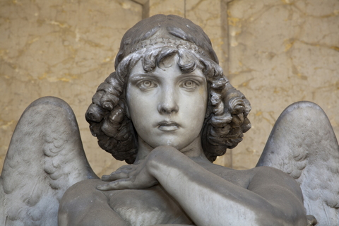 angel sculpture with penetrating eyes represents your conscience
