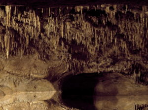 Cave with stalactites to introduce the idea of roots of issues being exposed by human rights