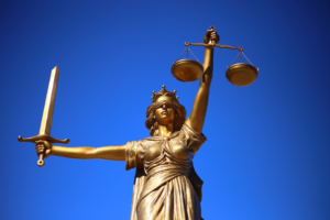 Statue of Justice holding up the balance scale