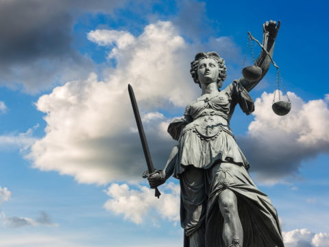 Statue of Justice against clouds